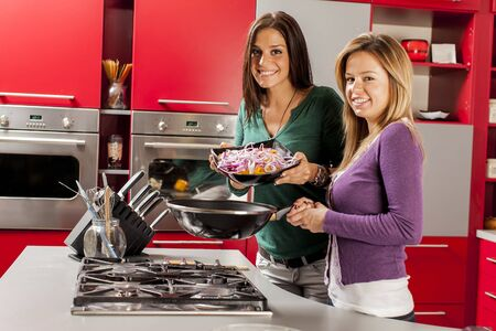 Young women in the kitchen Stock Photo - 21385290