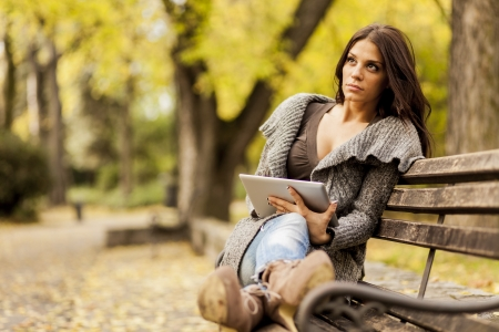 Young woman with tablet in the park photo