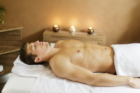 Young man in the spa photo