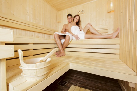 Young couple in the sauna photo