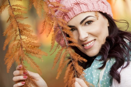 Young woman in the autumn forest photo