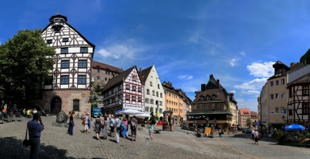 mention: Unidentified people in front of  Pilatushaus in Nuremberg at July 9, 2013. First documentary mention of the city of Nuremberg was in 1050. Editorial