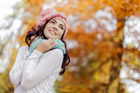 Young woman at autumn forest photo