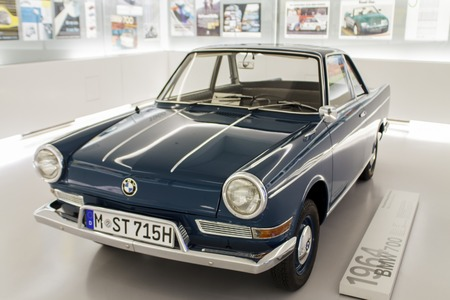 sold small: Munich, Germany - June 27, 2013  BMW 700 at BMW Museum in Munich  BMW 700 was a small rear-engined car produced by BMW in various models from August 1959 to November 1965  More than 188,000 were sold before production ended in November 1965