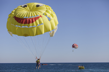 almost all: Unidentified people parasailing at Beldibi at October 7, 2013. Parasailing is popular on the coastal area of Turkey and almost all main hotels has parasailing activity.