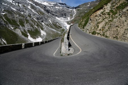 windings: Serpentine road in the italian Alps leads to Stelvio Pass