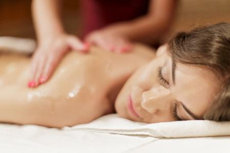 masseuse: professional masseuse  doing massage of female back