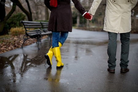 love in rain: Couple in the park on the rainy day Stock Photo