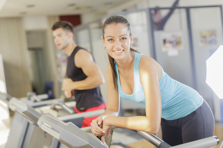 active lifestyle: Young woman training in the gym Stock Photo