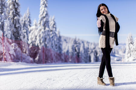 Young woman at winter photo