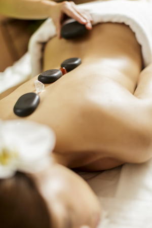 hot girl lying: Hot stone massage therapy