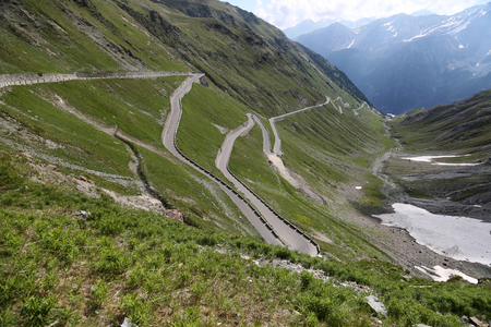 Serpentine road in the italian Alps leads to Stelvio Pass photo