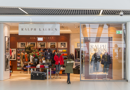 BUDAPEST, HUNGARY - JANUARY 15, 2014: Unidentified woman in front of Ralph Lauren shop in Budapest. Ralph Lauren is worldwide clothing company founded in 1967 in New York.