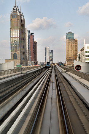 DUBAI, UNITED ARAB EMIRATES - JANUARY 16, 2014: Metro train in Dubai. Dubai Metro as the worlds longest fully automated metro network spanning at 75 kilometres.
