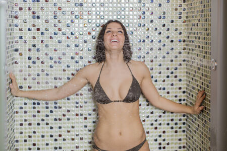 Young woman at the shower photo