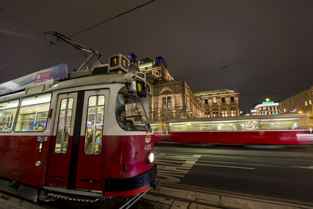 VIENNA AUSTRIA - FEBRUARY 5 2014: Trams at the street of Vienna at night. Vienna tramway network is one of worlds largest tram networks, at about 180 km in total length and 1031 stations. Editorial