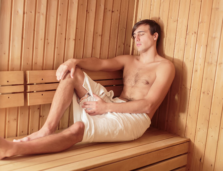 bathhouse: Young man relaxing in the sauna Stock Photo