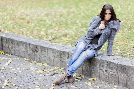 Young woman at autumn park photo