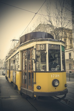 MILAN, ITALY - MARCH 8, 2014: Tram on the street of Milan. Milan Tramway Network In operation since 1881 and the network is now about 115 km long