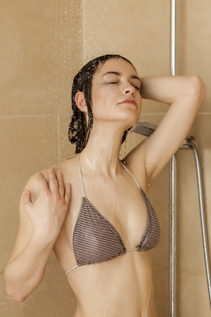 females: Girl taking shower