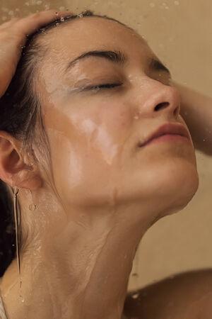 Girl taking shower photo