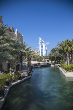 m hotel: DUBAI, UAE - JANUARY 16, 2014: View of hotel Burj al Arab from Madinat Jumeirah in Dubai. At 321 m, it is the fourth tallest hotel in the world and has 202 rooms.