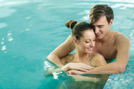 Young couple in the swimming pool photo