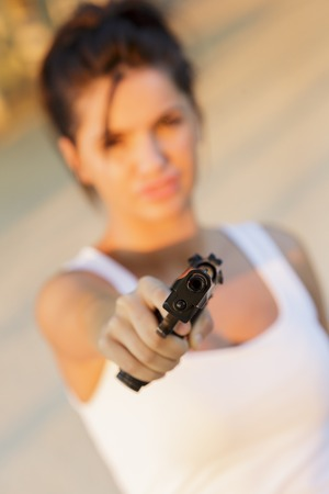 Young woman with a gun photo