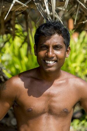 HIKKADUWA, SRI LANKA - JANUARY 22, 2014: Unidentified fisherman at Hikkaduwa in Sri Lanka. At 2013 there were around 220.000 marine fishers in Sri Lanka