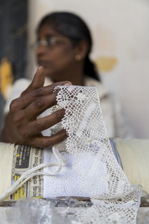 galle: GALLE, SRI LANKA - JANUARY 24, 2014: Unidentified woman making a lace in Galle, Sri Lanka. Galle is the most famous centre of lacemaking in Sri Lanka. Editorial