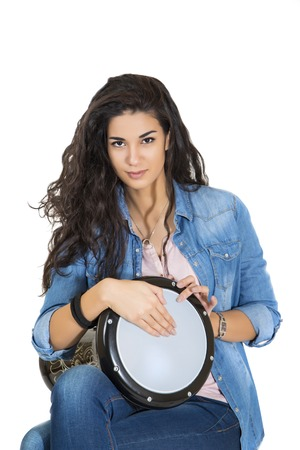 Young woman playing drum photo