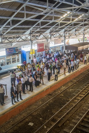colombo: Colombo, Sri Lanka - January 21, 2014  Unidentified passengers at Fort Railway Station in Colombo  Fort Railway Station is a major rail hub in Colombo and was opened in 1908