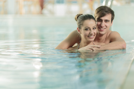 Young couple in swimming pool photo