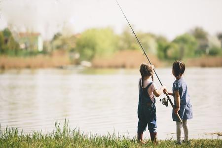 Two little girls fishing 스톡 콘텐츠