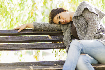 Girl on the bench photo