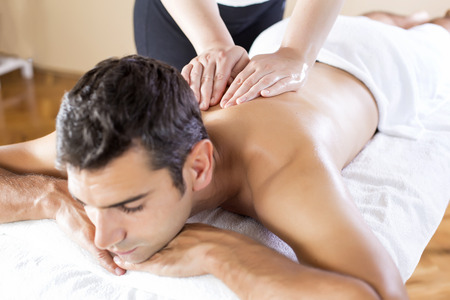 Young man having a massage photo