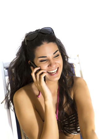 Young woman talking over the phone photo