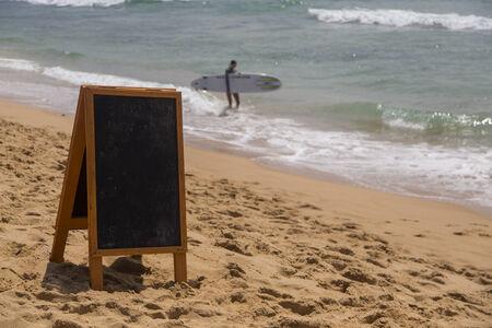 Blank board on the beach photo