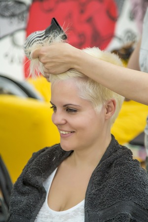 Young woman at hairdresser photo