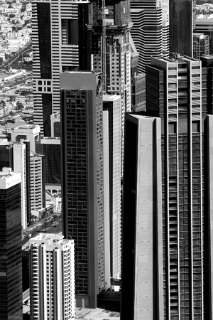 Dubai, UAE - January 17, 2010: View at Sheikh Zayed Road skyscrapers in Dubai. More than 25 skyscrapers taller than 100 meters can be found here.