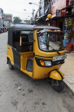 bajaj: COLOMBO, SRI LANKA - JANUARY 18, 2014: Auto rickshaw or tuk-tuk on the street of Colombo. Most tuk-tuks in Sri Lanka are a slightly modified Indian Bajaj model, imported from India.
