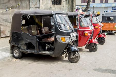 bajaj: COLOMBO, SRI LANKA - JANUARY 18, 2014: Auto rickshaws or tuk-tuks on the street of Colombo. Most tuk-tuks in Sri Lanka are a slightly modified Indian Bajaj model, imported from India.
