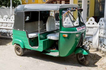 bajaj: UNAWATUNA, SRI LANKA - JANUARY 23, 2014: Auto rickshaw or tuk-tuk on the street of Unawatuna. Most tuk-tuks in Sri Lanka are a slightly modified Indian Bajaj model, imported from India.