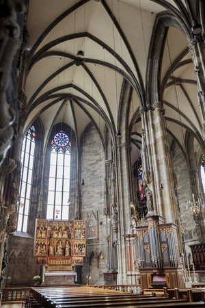 VIENNA, AUSTRIA - FEBRUARY 5, 2014: Interior of St. Stephens Cathedral in Vienna at night. This Roman Catholic church was opened at year 1160.