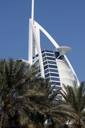Dubai, United Arab Emirates - November 15, 2010: View at hotel Burj al Arab from Madinat Jumeirah in Dubai. Madinat Jumeirah encompasses two hotels and clusters of 29 traditional Arabic houses.