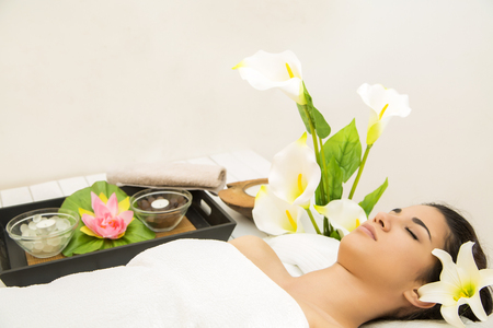 Pretty young woman having a massage photo