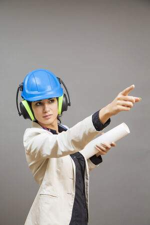 Young woman in protective workwear photo