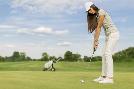 woman golf: Young couple playing golf