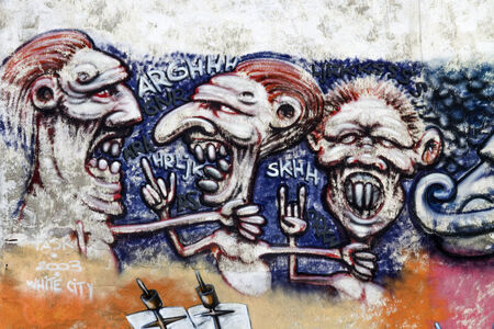 transforms: BELGRADE, SERBIA - APRIL 23, 2014: Graffiti on the walls in Savamala in Belgrade. Project Red Bull Door Deco transforms old and decayed doors at Savamala into creative field for graffiti artists