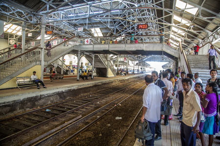 COLOMBO, SRI LANKA - JANUARY 21, 2014: Unidentified passengers at Fort Railway Station in Colombo. Fort Railway Station is a major rail hub in Colombo and was opened in 1908.